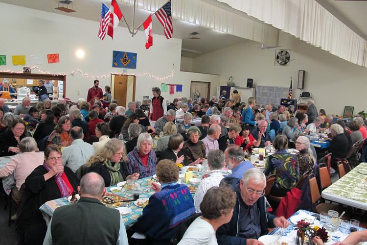 Folks enjoy dinner and auction