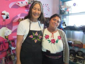 Linda wearing the apron that Teresa made